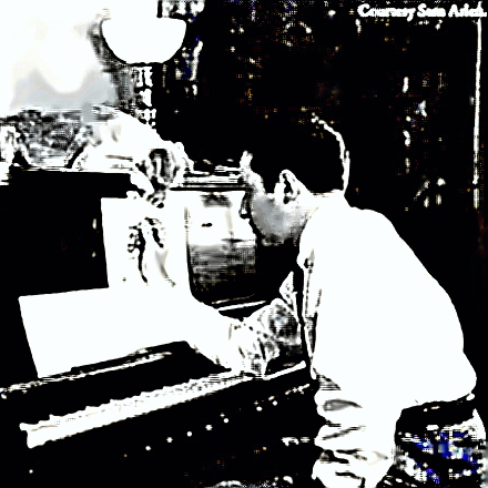 Composer Harold Arlen at piano with his dog Shmutts