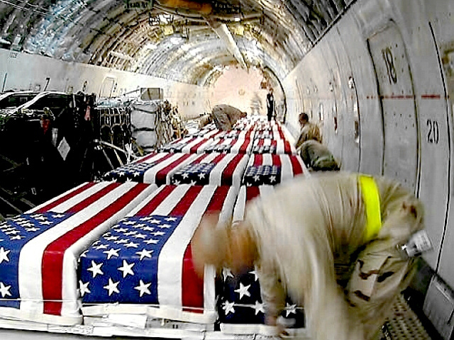 flag-draped coffins on USAF transport