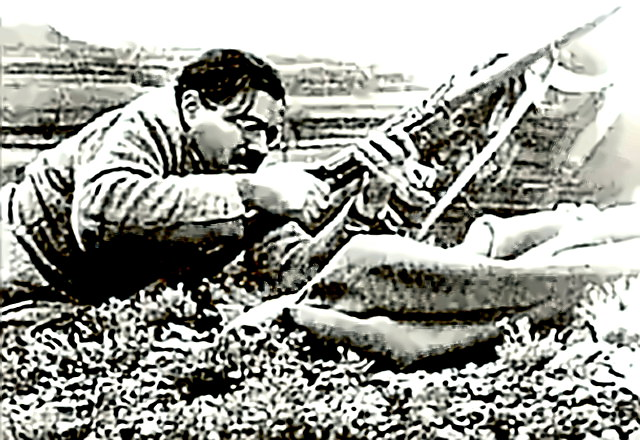 Hemingway in Spain with rifle