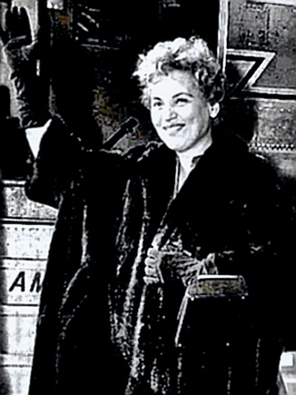 Judy Holliday waves goodbye from plane