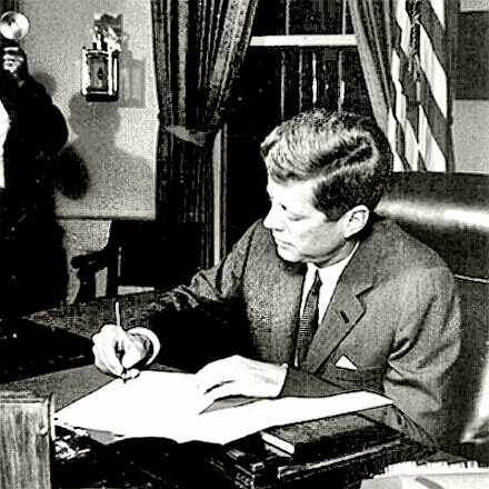 President Kennedy signs quarantine order during Cuban Missile Crisis