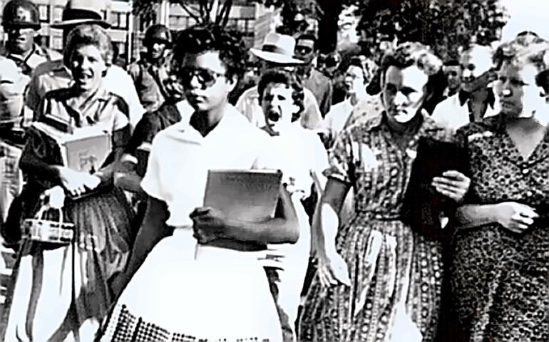 A Little Rock Nine Student with a crowd of her admirers