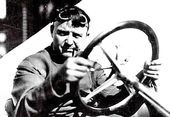 Barney Oldfield behind the wheel with his signature cigar