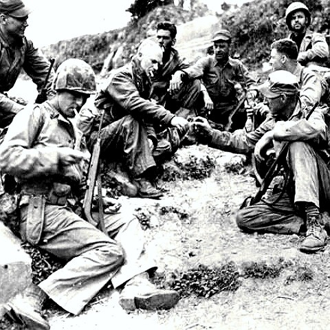 War correspondent Ernie Pyle with troops