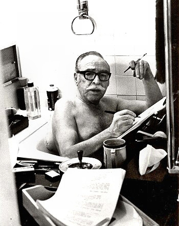 Writer Dalton Trumbo at work in his tub